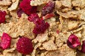 Corn flakes and red berries — Stock Photo