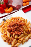 Pasta with bolognese sauce — Stock Photo