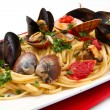 Delicious pasta with clams — Stock Photo