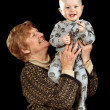 Grandmother holding young toddler — Stock Photo #5959215