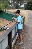 Boy taking photos — Stock Photo