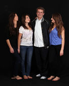 Three happy sisters and dad — Photo