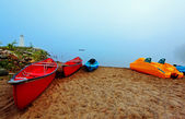 Canoes and kayaks at sunrise — Stock Photo