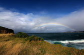 Rainbow over the ocean — Stock Photo