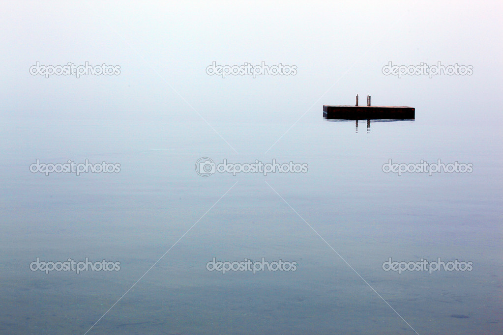 Swimming platform shrouded in early morning mist — Stock Photo #5960383