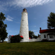 Lighthouse against sky — Stockfoto