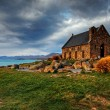 Church by a glacier lake - Stock Photo