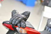 Motorcycle gloves with carbon on bike — Stock Photo