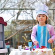Little girl having fun playing cooking — Foto Stock