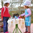 Little girls having fun playing cooking — 图库照片