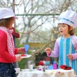 Stock Photo: Little girls having fun playing cooking