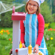 Little girl having fun playing cooking — Stock Photo #5444288
