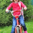 Little girl with bike — Stock Photo