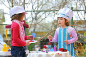 Little girls having fun playing cooking — Stock Photo