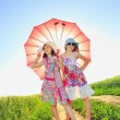Royalty-Free Stock Photo: Girls with a umbrella