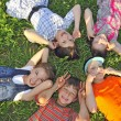 Children laying together on ground — Stock Photo #5736651