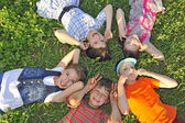 Children laying together on ground — Stock Photo