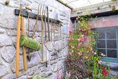 Garden tools on stone wall — Stock Photo