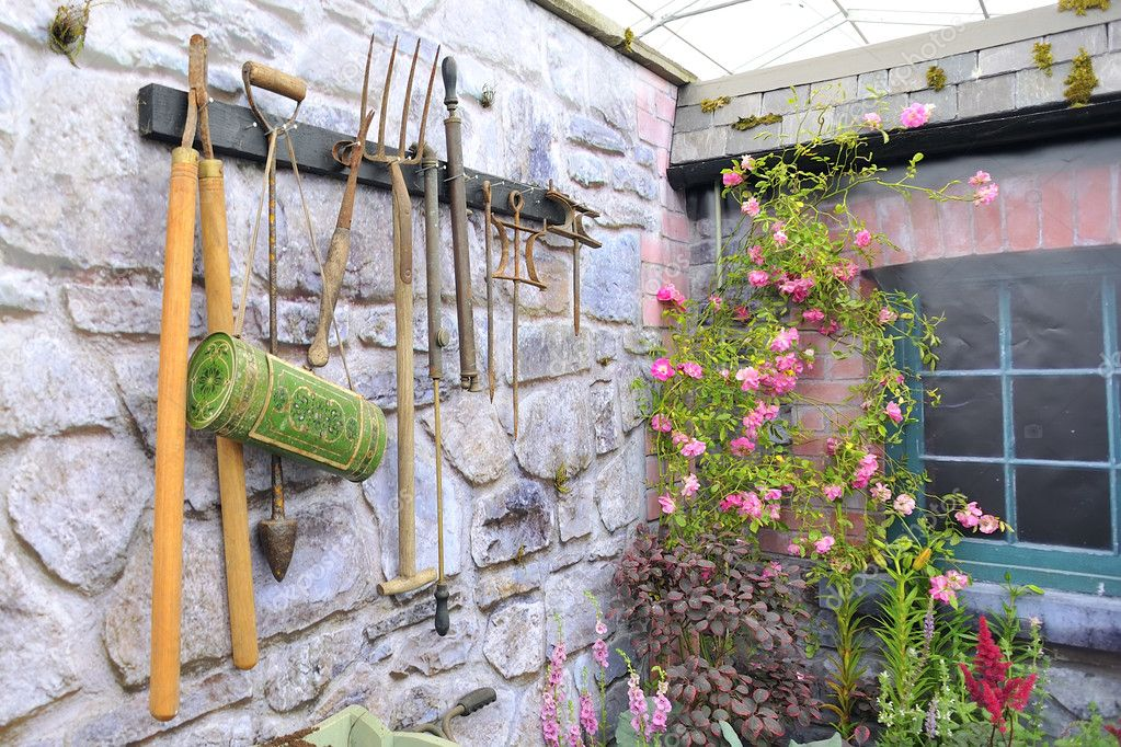 Garden tools on stone wall  Stock Photo #6011355