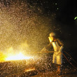 Worker using torch cutter to cut through metal — Lizenzfreies Foto