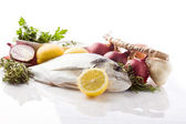 Photo of bream with different ingredients on white background — Stock Photo