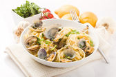 Pasta with Clams on white background — Stock Photo