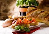 Bruschetta with ingredients — Stock Photo
