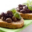 Bruschetta with olives - Stock Photo