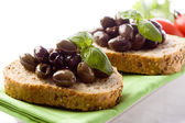 Bruschetta with olives — Stock Photo