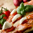 Pizza with Cherry Tomatoes and Buffalo Mozzarella - Zdjęcie stockowe