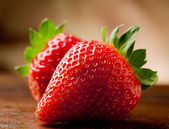 Strawberries on wooden table — Foto de Stock