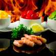 Grilled Prawns over flames — Stock Photo