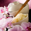 Asian rice dish with orchid flowers - Stok fotoğraf