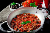 Tomato Sauce with basil and olives — Stock Photo