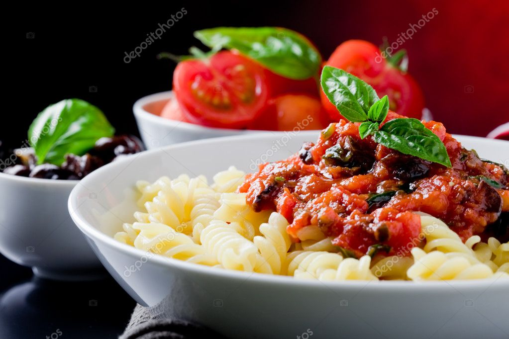Photo of delicious italian pasta with tomato sauce and basil     #5800709