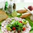 Octopus Carpaccio with mixed salad - Stock Photo