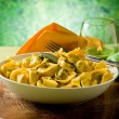 Royalty-Free Stock Photo: Tortellini with Butter and Sage with green background