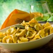 Tortellini with Butter and Sage with green background — Stock Photo