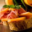 Ham and melon appetizer — Stock Photo #6279661