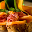 Ham and melon appetizer — Stock Photo