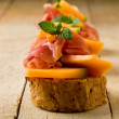 Stock Photo: Ham and melon appetizer