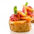 Ham and melon appetizer isolated — Stock Photo #6279800
