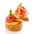 Ham and melon appetizer isolated — Stock Photo