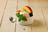 Ice Cream cup with fruits — Stock Photo