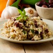 Risotto with black olives on wooden table — Stock Photo #6280394