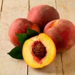 Peach on wooden Table — Stock Photo #6364248