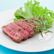 Beef steak with rosemary - Stock Photo