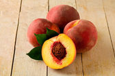 Peach on wooden Table — Stock Photo