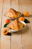 Croissants with apricot marmalade — Stock Photo