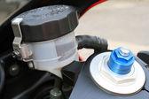 Motorcycle brake oil level and preload screw — Stock Photo